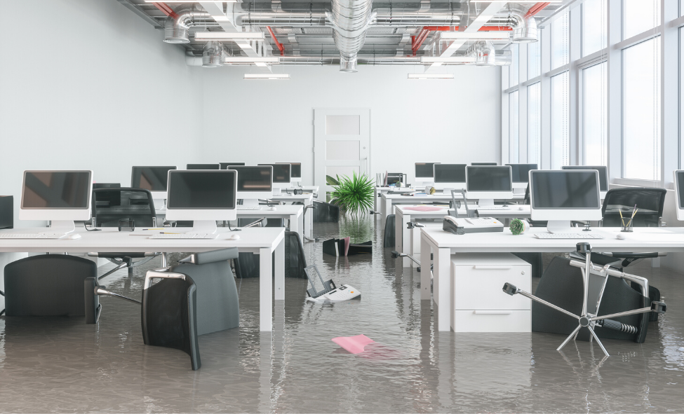 Flooded office requiring emergency flood services