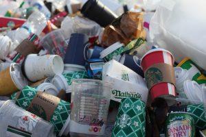 Coffee cups in trash bin
